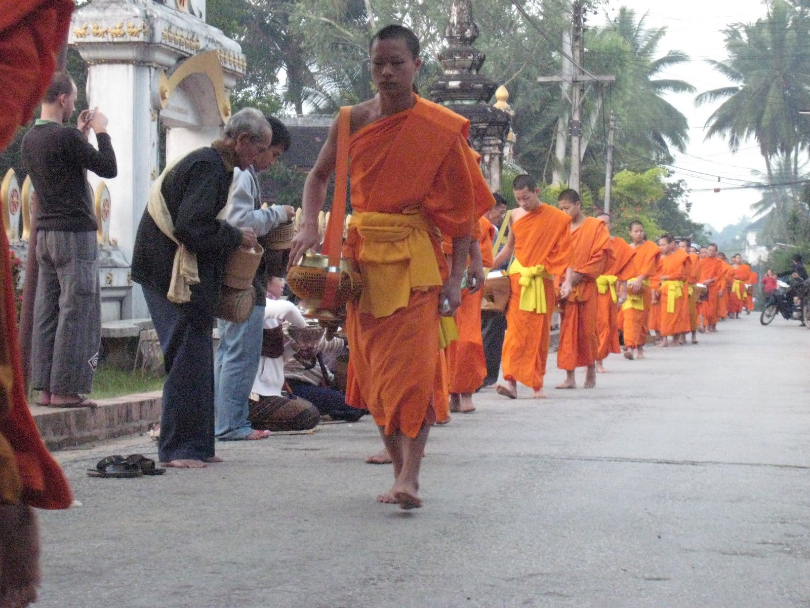 Four of our group woke up at 5:30 this morning and headed into town to participate in morning alms. All of the monks from all the temples in the area […]